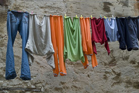 stock photo of loamy  - Multicolored washes are hanged up in the old town - JPG