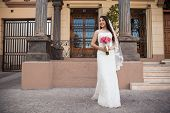 Hispanic Bride Outside A Courthouse