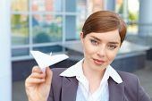 Businesswoman Launches Paper Airplane.