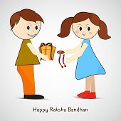 Cute little girl tying rakhi on her brother wrist and accepting gift on occasion of Raksha Bandhan f