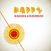Beautiful Rakhi on grey background for the festival of Raksha Bandhan celebrations.