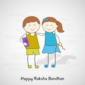 Happy cute little brother and sister on occasion of Raksha Bandhan celebrations on grey background.