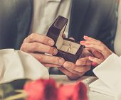 stock photo of propose  - Man holding box with ring making propose to his girlfriend - JPG