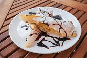 Piece of cherry strudel with chocolate.