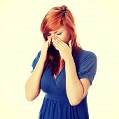 stock photo of sinus  - Young woman with sinus pressure pain - JPG