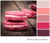 A stack of raspberry macaroon, vintage style over old wooden table,, in a colour palette with compli