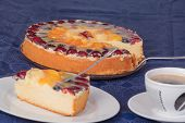 Fruit cake with coffee and cake plate