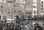 Water canal and typical architecture in city Amsterdam