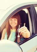 vehicle, rental, automotive concept - happy woman holding car key