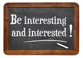 be interesting and interested -  social media reminder and concept - white chalk text  on a vintage