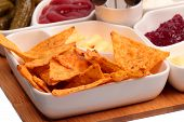 stock photo of picking tray  - Snacks plate with tortilla chips and other snacks - JPG