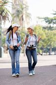 two young female tourists walking in the city