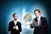 Businessman and businesswoman touching icon of digital screen. Elements of this image are furnished