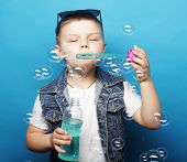 little boy with soap bubbles