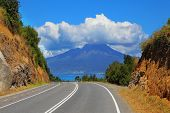 The road leads to the famous volcano Osorno. Top of the volcano cloud closed. Scenic highway in Sout