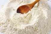 wooden spoon with soft wheat flour