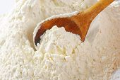wheat flour with wooden spoon