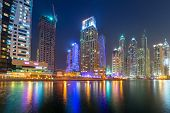 DUBAI, UAE - 31 MARCH 2014: Skyscrapers of Dubai Marina at night, UAE. Dubai Marina is a district in