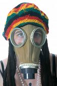a girl in a gas mask wears her favorite Rastafarian style hat with built in Dred locks. isolated on white with room for your text.