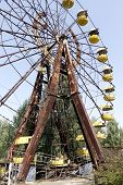 Ferris wheel in Pripyat - abandoned city near Chernobyl nuclear reactor. Whole city was abandoned af