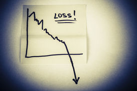 foto of going out business sale  - close up of a note paper with finance business graph going down  - JPG