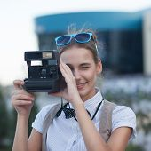 Stylish Girl Taking A Photo In The City