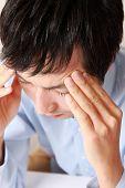 man suffers from headache