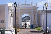 image of san juan puerto rico  - Silhouette of man walking through arch of Santa Maria Magdalena de Pazzis cemetery in Old San Juan Puerto Rico - JPG