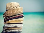 foto of beach hat  - Colorful hats for sale on the beach travel concept - JPG