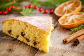 Christmas Piece Of Biscuit Cake With Mandarin Oranges And Cinnamon