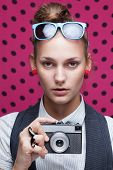 Fashionable Teen With Old Camera In Checkered Red Shirt And Bow-tie.