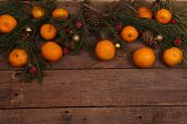 New Year's still-life with tangerines and pine cones