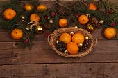 fur-tree branches both fresh tangerines and gold spheres