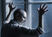 pic of hospital gown  - Bald woman suffering from cancer leaning on the hospital window - JPG