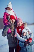 Happy family in winterwear outside
