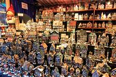 stock photo of stall  - Christmas decorations of houses at a Christmas market stall - JPG