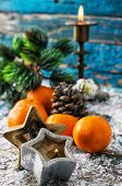 picture of tangerine-tree  - Christmas decorations with Christmas tree,candles and tangerines