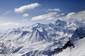 Snowy Winter Mountains In Sun Day