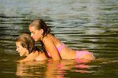 Teenage Girls Lying In The River
