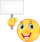 Smiley emoticon holding a blank sign