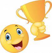 Happy smiley emoticon holding trophy