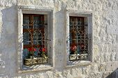 stock photo of goreme  - Flowered windows in the town of Goreme - JPG