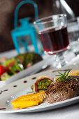 image of flambeau  - steak with a rosemary leaf and red wine