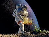 Astronaut planting grass on the planet.