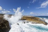 Waves crashing into Boka Pistol bay at Shete Boka National Park Curacao