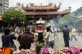 TAIPEI, TAIWAN - November 16th : Many believers to worship in Longshan Temple, Taiwan on November 16th, 2014.