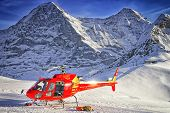 Red Helicopter At Swiss Ski Resort Near Jungfrau Mountain