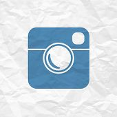 Hipster Photo Icon on Crumpled Paper Texture. Raster version
