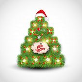 Shiny beautiful X-mas Tree decorated by mistletoe, Santa cap and tag of Merry Christmas on shiny grey background.