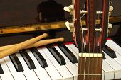 Drum Sticks, Guitar And Piano Keyboard